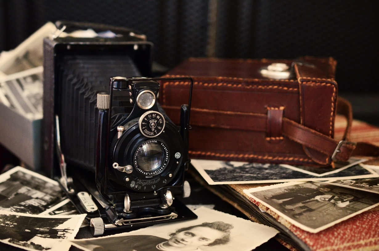 A vintage camera and photographs