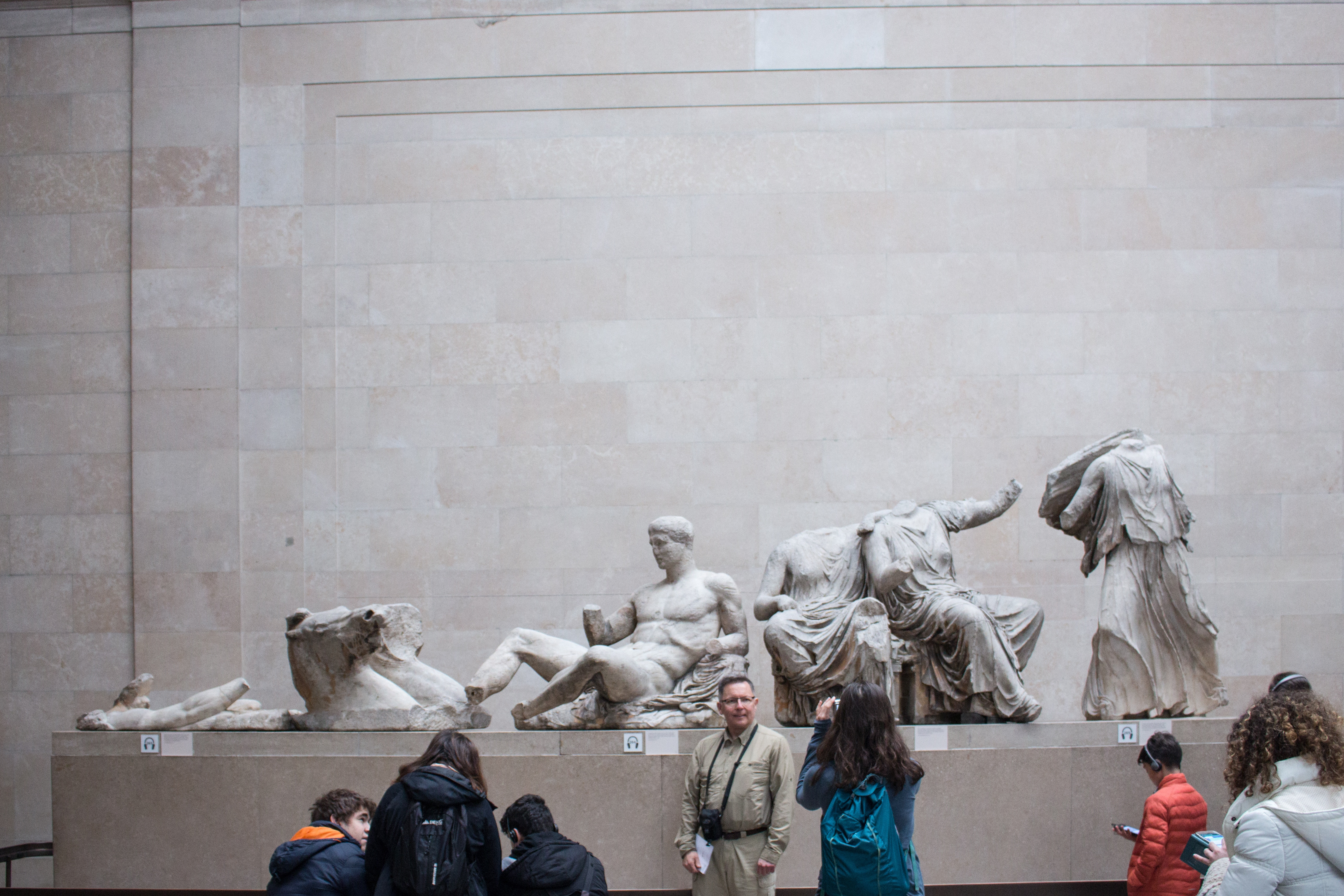 People looking at statues in the British Museum. By Nicole Baster.