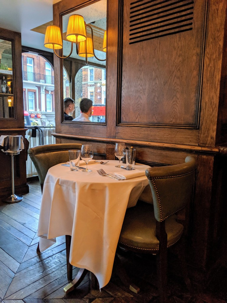 Classic decor and seating at Café Monico