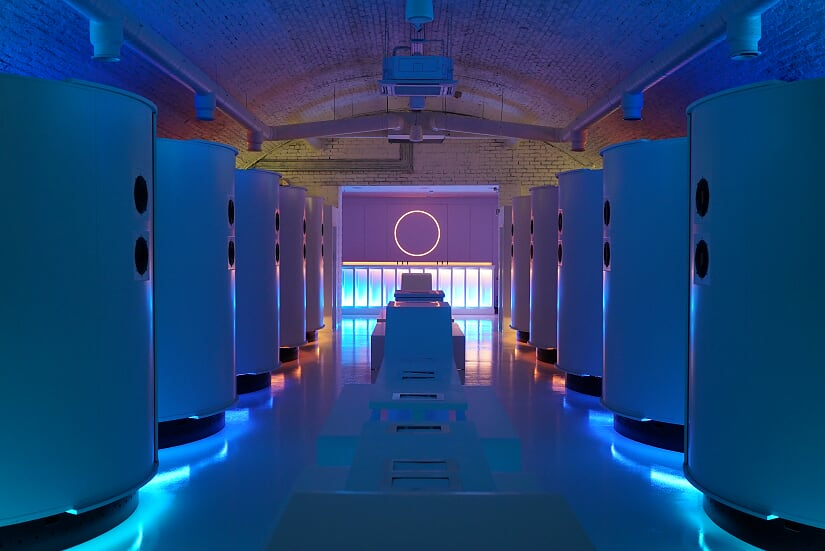 The interior of Virtual Reality Arcade Otherworld located in London, with a central bar and virtual reality rooms